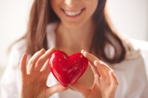 close-up-of-woman-holding-a-bright-heart_1098-2725-300x200